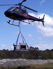 Chopper flying in Acid Solutions Pty Ltd machinery